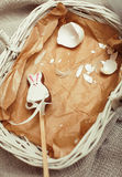 Celebration for easter card, candy toy bunny with. Crashed egg on paper in basket vintage brown Stock Image