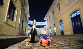 After celebration. An empty bottle of champagne and a box of firecrackers on road after the celebrations Stock Photography