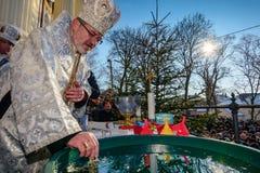 Celebration of the Epiphany Day. UZHGOROD, UKRAINE - January 19, 2017: Ceremony Greek-Catholic church during celebration of the Epiphany Day royalty free stock photos