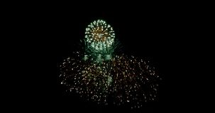 Celebration firework exploding and glow over dark background with dark and grain processed. 4K Celebration firework exploding and glow over dark background with stock video