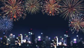 Celebration fireworks at night in the city,  Bokeh lights of building at night Royalty Free Stock Photography