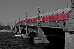 Celebration. Flagged Bridge. Russia. Summer. Celebration. Flagged bridge in St. Petersburg emphasizes the beauty of this metal bridge with magnificent lanterns Royalty Free Stock Photography
