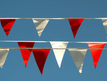 Celebration flags 2. Red and white flags against blue sky stock images