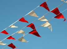 Celebration flags. Red and white flags against a blue sky Royalty Free Stock Image