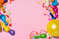 Celebration Flat lay. Candy with colorful party items on pink ba Stock Photography