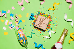 Celebration Flat lay. Gift box with colorful party items on gree Royalty Free Stock Photography
