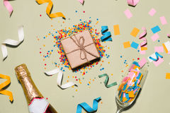 Celebration Flat lay. Gift box with colorful party items on gree Stock Photography