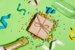 Celebration Flat lay. Gift box with colorful party items on gree Royalty Free Stock Image