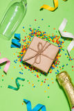 Celebration Flat lay. Gift box with colorful party items on gree Royalty Free Stock Images