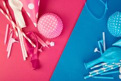 Party pink and blue paper hat. Celebration Flat lay. Party pink and blue hat polka dot background. Birthday paper hat, candles, tubes and balloons stock photo
