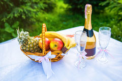 Celebration food on the table. With wine, glasses and bouquet Stock Image