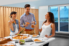 Celebration. Friends Having Dinner Party. Eating Pizza, Drinking Royalty Free Stock Image