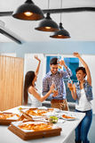 Celebration. Friends Having Dinner Party. Eating Pizza, Drinking Royalty Free Stock Images