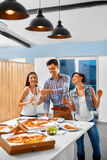 Celebration. Friends Having Dinner Party. Eating Pizza, Drinking Royalty Free Stock Photography