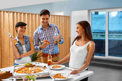 Celebration. Friends Having Dinner Party. Eating Pizza, Drinking Stock Photography