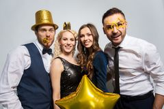 Happy friends with golden party props posing royalty free stock photos
