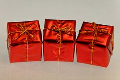 Parcels wrapped in Christmas burgunday stock image