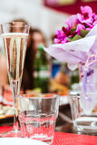 Celebration. Glass of champagne on birthday party Royalty Free Stock Photo