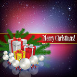 Celebration greeting with Christmas gifts and decorations Stock Image