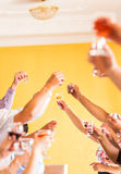 Celebration. Hands holding the glasses of champagne and wine making a toast Stock Photos