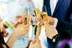 Celebration. Hands holding the glasses of champagne and wine making a toast. The party, alcohol, lifestyle, friendship, holiday, christmas, new, year and stock image