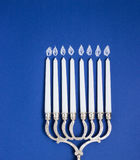 Celebration of Hanukkah. Candlestick on blue background, top view.  Royalty Free Stock Photography