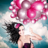 Celebration. Happy Fashion Woman Holding Balloons Stock Photo