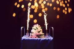 Celebration, holiday birthday cake with candles and fireworks, b. Right lights bokeh on a black background stock images