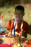Celebration, holiday birthday cake with candles and fireworks light on a black background Stock Photos
