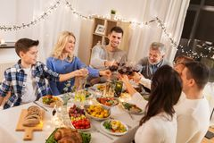 Happy family having dinner party at home stock photography