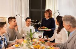 Happy family having dinner party at home stock images