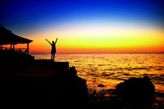 Celebration of life. Happy Winning Success Woman at Sunset or Sunrise Standing Elated with Arms Raised up Above Her Head, hello life, celebration of life royalty free stock photos