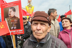 During the celebration of May Day. Communist party supporters take part in a rally. Royalty Free Stock Photo