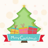 Celebration of Merry Christmas with colorful gift boxes and X-mas tree. Merry Christmas celebration with Xmas tree and gift boxes  on stylish background Royalty Free Stock Image