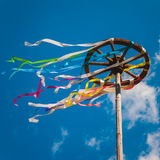 Celebration of Midsummer. Wooden wheel with bright ribbons Stock Image