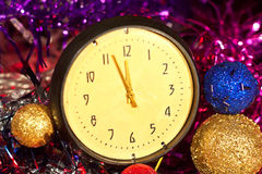 Celebration of the new year. The old clock shows five minutes to twelve Royalty Free Stock Photo