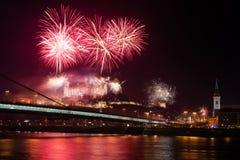 Celebration of New Year in Bratislava, Slovakia. BRATISLAVA, SLOVAKIA - JANUARY 1: New Year fireworks above Danube river on January 1, 2013 in Bratislava Royalty Free Stock Images