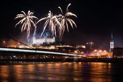 Celebration of New Year in Bratislava, Slovakia. BRATISLAVA, SLOVAKIA - JANUARY 1: New Year fireworks above Danube river on January 1, 2013 in Bratislava Stock Images