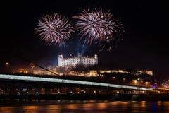 Celebration of New Year in Bratislava, Slovakia. BRATISLAVA, SLOVAKIA - JANUARY 1: New Year fireworks above Danube river on January 1, 2013 in Bratislava Stock Image