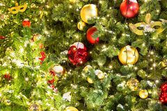 Celebration of New Year and Christmas background. Details of a Christmas tree. Detail shot of Christmas tree branches with Christm. As toys, lights and snow Stock Photo
