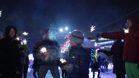 Celebration of the New Year and Christmas at night in the city center with families and children. parents and children