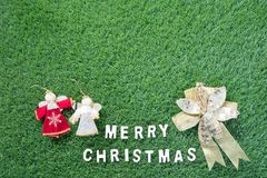 Christmas alphabet and decoration on green grass Royalty Free Stock Image