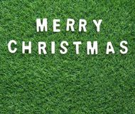 Christmas alphabet on green grass. Celebration of New year and Christmas, Top view Christmas alphabet on green grass background Royalty Free Stock Photos