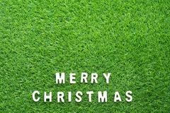 Christmas alphabet on green grass. Celebration of New year and Christmas, Top view Christmas alphabet on green grass background Stock Images