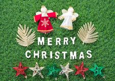 Christmas alphabet and decoration on green grass. Celebration of New year and Christmas, Top view Christmas alphabet and decoration on green grass background Stock Photography