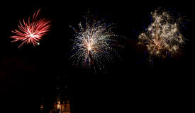 Celebration of the new year with fireworks. In Sweden. The church in Uppsala in the background Royalty Free Stock Images