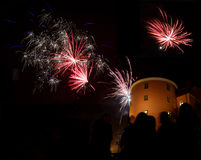 Celebration of the new year with fireworks. In Sweden. Silhouette of people and the castle in Uppsala in the background Royalty Free Stock Photo