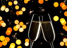 Celebration on New Year`s Eve. Close up of two glasses of Champagne clinking together Royalty Free Stock Images
