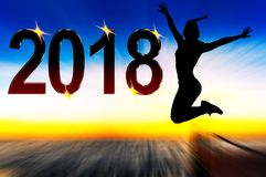Celebration of the New Year 2018. Silhouette of young woman jumping on high Stock Photography