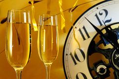 Celebration of the new year. Two glasses and a watch for the celebration of the new year Royalty Free Stock Image